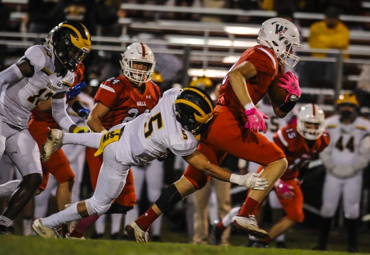 Matt Dollive of Wall, tries to break free from Anthony Brett of St. John Vianney in a game in Wall on Oct.18, 2019.