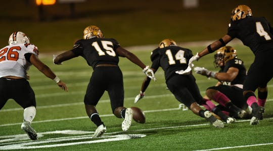Abilene High's Jaryn Carillo-Talmadge (14) leads the way after a first-half Abilene High pooch kickoff to the Haltom Buffalos went straight up, then bounced toward the Eagles' end of the field. D'Anthony Franklin (30) also was near the ball and recovered for Eagles on Friday at Shotwell Stadium.