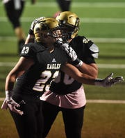 Abilene High running back Esai Jaques (23) is congratulated by a teammate after scoring his team's second touchdown against Haltom at on Oct. 18 Shotwell Stadium. The Eagles won the game 35-18, a week after Haltom upset unbeaten Euless Trinity.