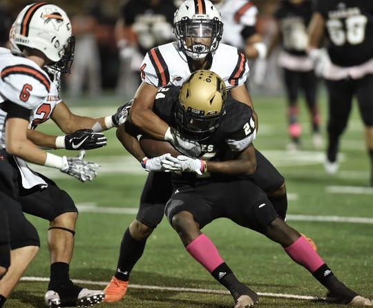 Abilene High receiver Jeshari Houston is corralled after making a catch downfield Friday night against Haltom at Shotwell Stadium in a District 3-6A game.