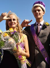 With their guns up, 2019 Hardin-Simmons University homecoming queen Elizabeth Bygeol, of Lubbock, and king Parker Johnson, of Piedmont, Oklahoma, participate in the performance of the school song Saturday at Shelton Stadium.
