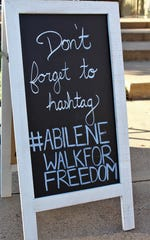 Walk for Freedom sign Saturday at Everman Park.