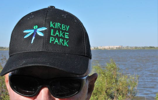 Texas Parks & Wildlife's Mike Cornett wore his Kirby Lake Park cap for the first time at Saturday morning's cleanup event at the south Abilene site. Oct. 19 2019