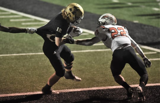 Abilene High's Eric Abbe can't be stopped as he gets into the end zone for a second quarter touchdown Friday against the Haltom Buffalos. Johnny Smith-Rider (22) is too late to make the stop.
