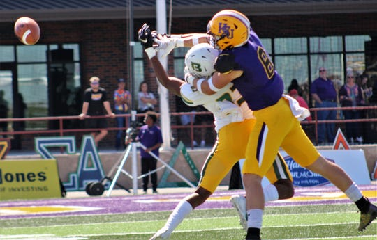 Hardin-Simmons safety Blake Johnston (8) knocks the ball away from a Belhaven receiver in the first half Saturday at Shelton Stadium.