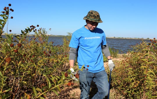 Ferman Cisneros was one of three Bandag employees who volunteered with Saturday's Kirby Lake Park cleanup. With foliage still in bloom, volunteers had to keep their eyes peeled for trash. Oct 19 2019