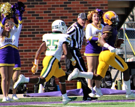 aquan Hemphill scores the first of two long touchdowns Saturday against Belhaven on this 72-yard catch-and-run play from quarterback Kyle Jones. Hemphill later scored on a 54-yard pass from Jones as Hardin-Simmons earned a 63-7 homecoming victory at Shelton Stadium.