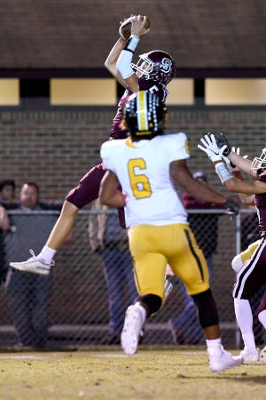 Swain County's Connor Hyatt intercepts a Murphy pass during their game at Swain County High School on Oct. 18, 2019.