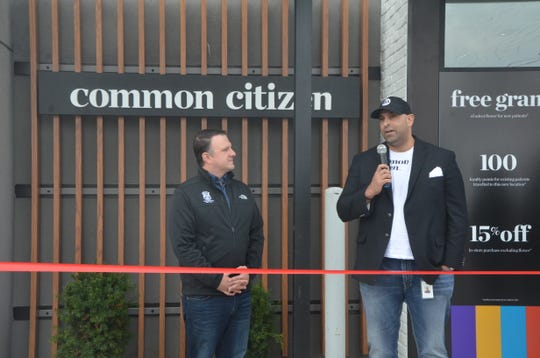 Mike Elias (right), CEO and president of Common Citizen, addresses the crowd on Saturday at the businesses grand opening with State Representative Matt Hall (left).