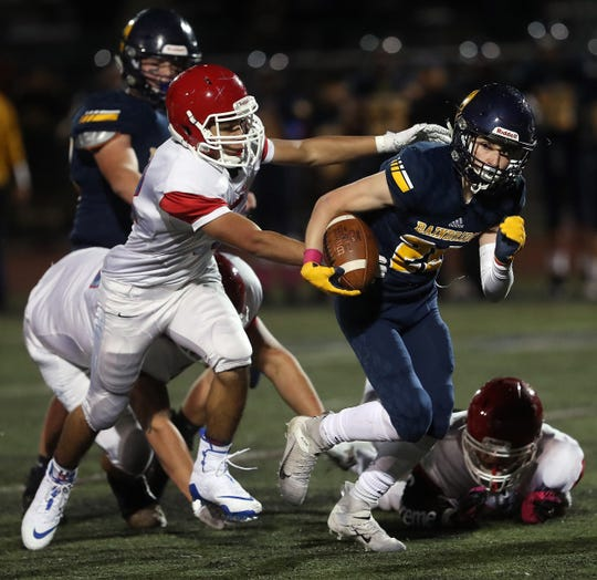 Chief Sealth's  Jesse Brown makes a grab for Bainbridge's Cal Breen on Friday, October 18, 2019.