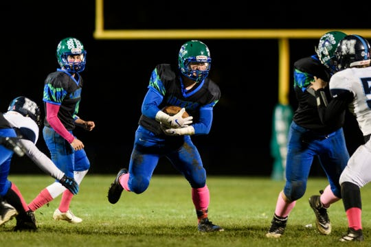 Colchester's Charlie Cusson-Ducharme (19) runs with the ball during the high school football games between the Mount Mansfield Cougars and the Colchester Lakers at Colchester High School on Friday night October 18, 2019 in Colchester, Vermont.