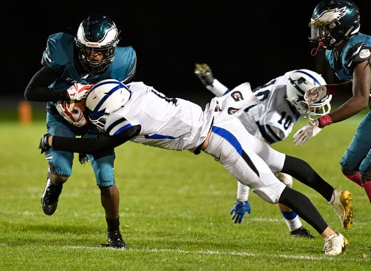Hammonton's Kyle Vandever takes down Winslow's Jayden Brown during Friday night's football game. The visiting Blue Devils topped the Eagles 29-0 on Oct. 18, 2019.
