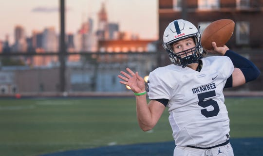 Shawnee's Matt Welsey warms up on the Union City High School football field, located on the roof of Union City High School, prior to the football game between Shawnee and Union City, on Friday, October 18, 2019.