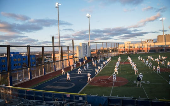 The Shawnee High School football team warms up on the Union City High School football field, located on the roof of Union City High School, prior to the football game between Shawnee and Union City, on Friday, October 18, 2019.