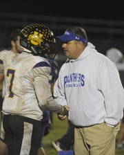 Unioto running back Jamarcus Carroll and Southeastern head coach Evan Gallaugher talk after Southeastern's 28-21 win at Southeastern High School on Friday, Oct. 18, 2019 in Chillicothe Ohio.