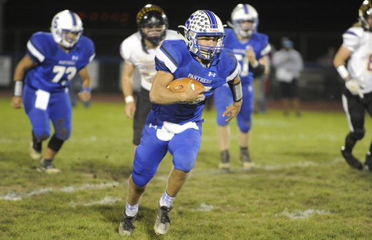 Southeastern quarterback Lane Ruby runs the ball during a 28-21 win over Unioto High School at Southeastern High School on Friday, Oct. 18, 2019 in Chillicothe, Ohio.