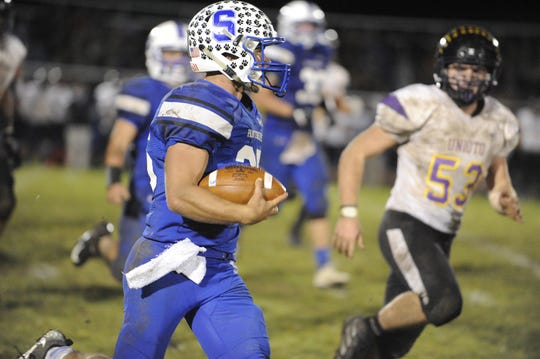 Southeastern quarterback Lane Ruby runs the ball during a 28-21 win over Unioto at Southeastern High School on Friday, Oct. 18, 2019 in Chillicothe Ohio.