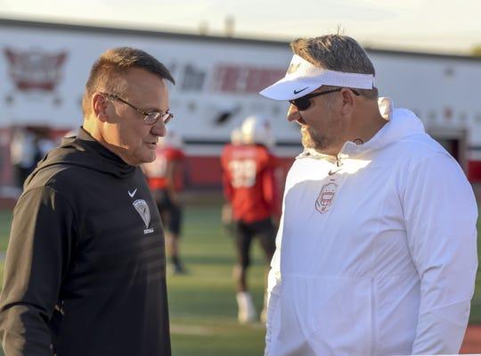 Head coach Tom Bolden of Lakota West talks to Rick Haynes of Lakota East before the game at the Skyline Chili Crosstown Showdown on Friday, October 18, 2019, Lakota West High School
