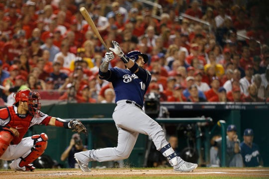 Oct 1, 2019; Washington, DC, USA; Milwaukee Brewers catcher Yasmani Grandal (10) hits a two run home run during the first inning against the Washington Nationals in the 2019 National League Wild Card playoff baseball game at Nationals Park. Mandatory Credit: Geoff Burke-USA TODAY Sports