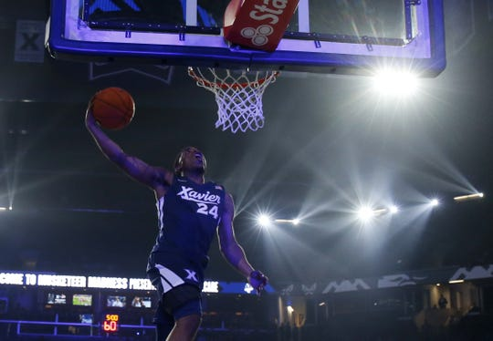 Kyky Tandy dunks in the dunking contest during Musketeer Madness at Xavier University, Friday, Oct. 18, 2019, in Cincinnati.
