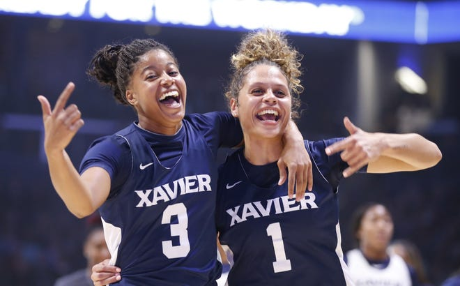 Aaliyah Dunham, left and Nia Clark celebrate their team's win in a scrimmage during Musketeer Madness at Xavier University's Cintas Center on Oct. 18, 2019.