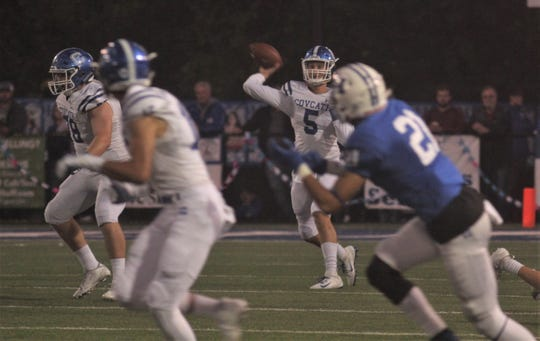 Covington Catholic junior quarterback Caleb Jacob fires a pass to Ethan Reardon for a long touchdown as CovCath defeated Highlands, 13-0, in their football rivalry game on Oct. 18, 2019, at Highlands High School in Fort Thomas, Kentucky