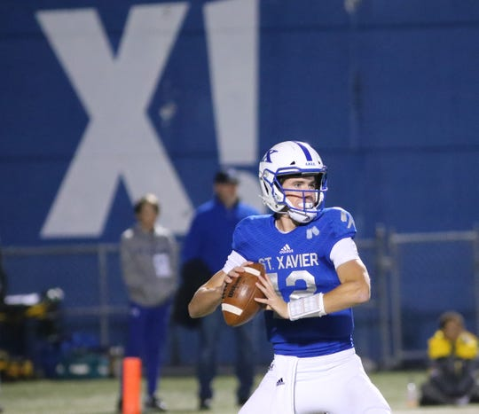 St. Xavier Qb Matthew  Rueve  passes the ball during the Bombers football game against Lasalle, Friday, Oct. 18, 2019.