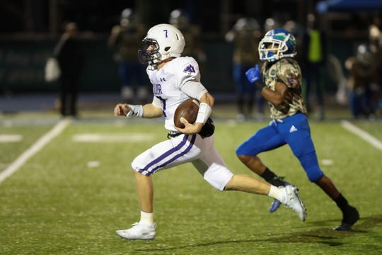 Elder Panthers quarterback Matthew Luebbe (7) carries the ball for a touchdown during the game against the Elder Panthers and the Winton Woods Warriors on October 18th 2019, at Winton Woods High School.