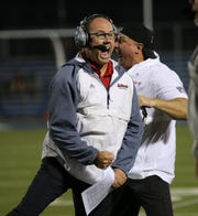 Lasalle head coach Pat McLaughlin reacts during the Lancers win over St. Xavier , Friday, Oct. 18, 2019.