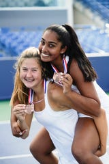 Mason's Annie Kruse and Raina Chada pose together after coming in third place in the doubles division I during the Ohio girls tennis state tournament on Saturday, Oct. 19.