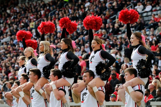 The Cincinnati Bearcats cheerleaders perform in the first quarter of the NCAA American Athletic Conference game between the Cincinnati Bearcats and the Tulsa Golden Hurricane at Nippert Stadium in Cincinnati on Saturday, Oct. 19, 2019.