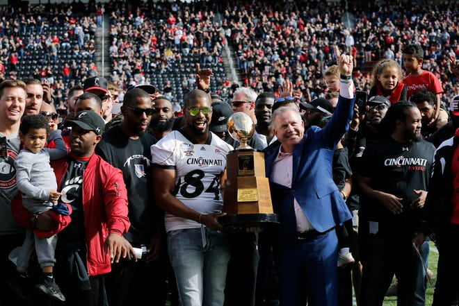 Brian Kelly and the 2009 Bearcats football team stand on the field to be honored during a timeout in the first quarter of the NCAA American Athletic Conference game between the Cincinnati Bearcats and the Tulsa Golden Hurricane at Nippert Stadium in Cincinnati on Saturday, Oct. 19, 2019.