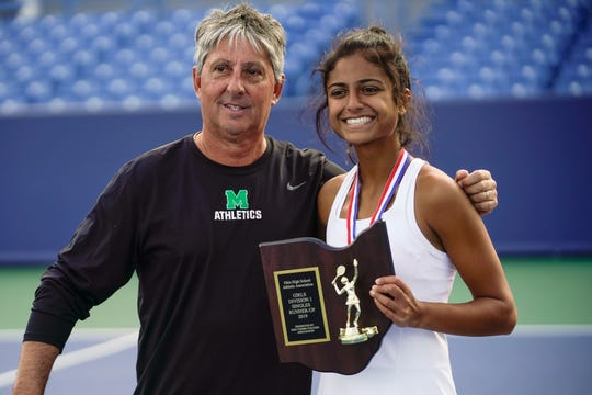 Mason's Ananya Aggarwal poses with coach Mike Reid and the division I singles runner-up plaque after the championship match at the Ohio girls tennis state tournament on Saturday, Oct. 19.
