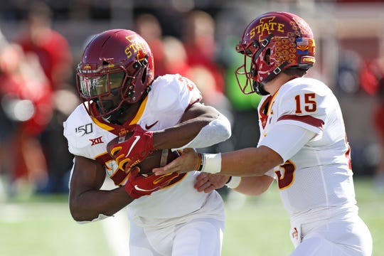 Iowa State's Brock Purdy (15) hands the ball off to Breece Hall (28) during the first half of an NCAA college football game against Texas Tech, Saturday, Oct. 19, 2019, in Lubbock, Texas.