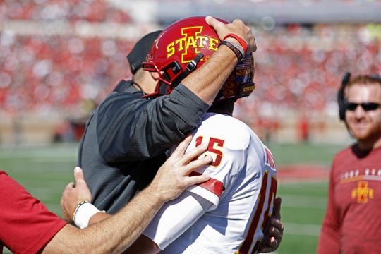 Iowa State coach Matt Campbell hugs Brock Purdy (15) after scoring a touchdown during the first half of an NCAA college football game against Texas Tech, Saturday, Oct. 19, 2019, in Lubbock, Texas.