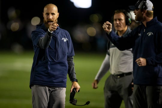Roosevelt head coach Mitchell Moore yells on the field during their football game on Friday, Oct. 18, 2019 in Ankeny. Ankeny Centennial takes a 14-7 lead over Roosevelt into halftime.