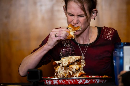 Competitive eater Molly Schuyler takes on The Emmenecker Challenge at Jethro's BBQ Steak and Chop on Saturday, Oct. 19, 2019 in Ames. The challenge involves eating the 5 pound sandwich in under 15 minutes. Molly held the previous record of 4 minutes and 40 seconds before beating it Saturday with a time of three minutes and one second.