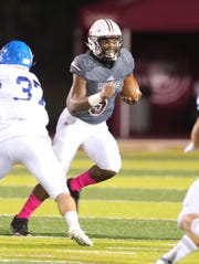 River Rouge high schools Mareyohn Harbowski runs the ball against Detroit Catholic Central high school during first half action Friday, October 18, 2019 in at River Rouge high school in River Rouge, Mich.