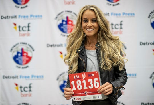 Detroit Free Press/TCF Bank Marathon race ambassador Nicole Curtis poses for a photo with her running bib at TCF Center in downtown Detroit, Friday, Oct. 18, 2019.