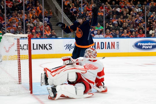 Edmonton Oilers center Ryan Nugent-Hopkins (93) celebrates as Detroit Red Wings goaltender Jonathan Bernier (45) reacts to a goal during the second period of an NHL hockey game Friday, Oct. 18, 2019, in Edmonton, Alberta.