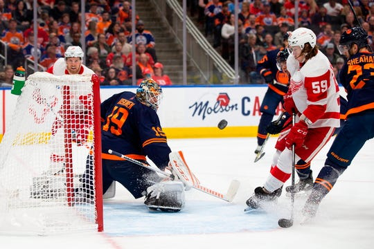 Edmonton Oilers goaltender Mikko Koskinen (19) makes a save against Detroit Red Wings left wing Tyler Bertuzzi (59) during the first period of an NHL hockey game Friday, Oct. 18, 2019, in Edmonton, Alberta.