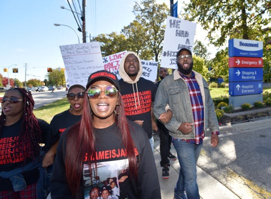 Paige White, center, marches with her mother, Martha Chambers, left, sister Chanelle White, brother, Joseph White and Pastor K.C. Pierce, III, in front of Beaumont Hospital on Oakwood. Pierce is pastor of Hopewell Baptist Church and chairman of religious affairs for the NAACP-Detroit Branch.