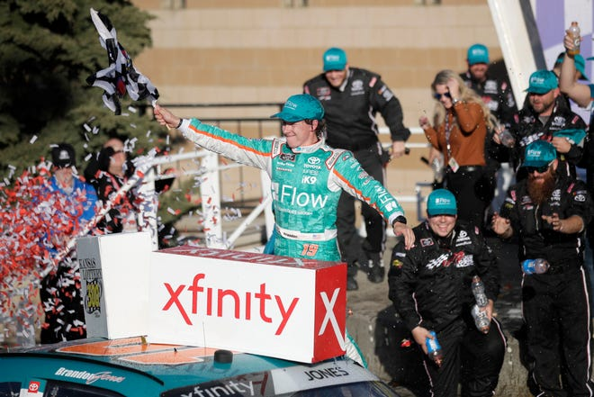 Brandon Jones celebrates in Victory Lane after winning Saturday's NASCAR Xfinity race at Kansas Speedway.