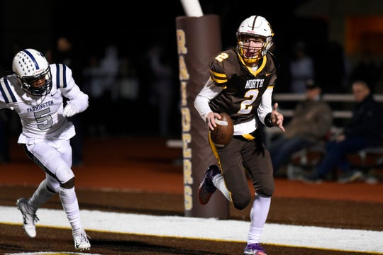 North Farmington quarterback Jacob Bousamra, right