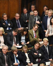 Lawmakers crowd the benches, with Oliver Letwin, top 3rd from left, and brother of the prime minister lawmaker Jo Johnson at bottom right, as they listen to Britain's Prime Minister Boris Johnson as he gives a Brexit statement to lawmakers inside the House of Commons, in London Saturday Oct. 19, 2019.  Lawmakers are to be granted a chance to vote Saturday on the 'Oliver Letwin Amendment' to the Brexit deal, which may delay their final decision on Brexit. (Jessica Taylor/House of Commons via AP)