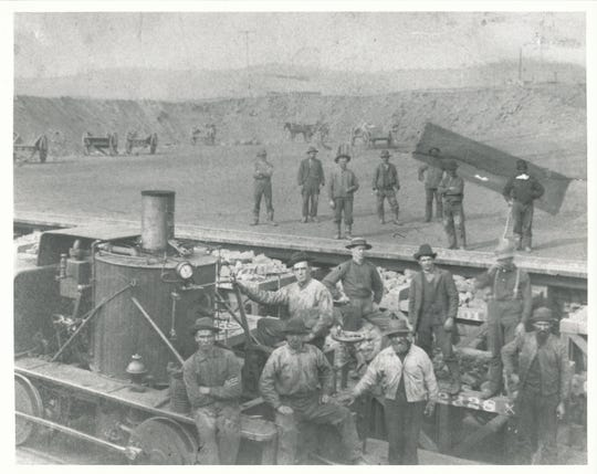 Miners pose with the Yankee locomotive at the Jackson Mine, Negaunee, circa 1880.