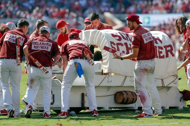 The Oklahoma Sooner Schooner flipped over during a touchdown celebration on the field during the first half Saturday.