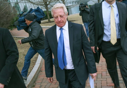 FILE - In this March 29, 2019, file photo, Robert Flaxman, founder and CEO of Crown Realty & Development, leaves the federal courthouse in Boston after a hearing in a nationwide college admissions bribery scandal. Flaxman is scheduled to be sentenced on Friday, Oct. 18.