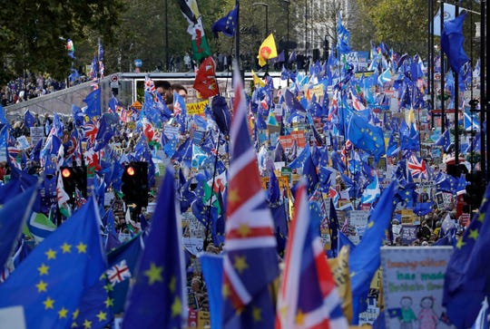 "Anti-Brexit remain in the European Union supporters take part in a ""People's Vote"" protest march calling for another referendum on Britain's EU membership, in London, Saturday, Oct. 19, 2019."