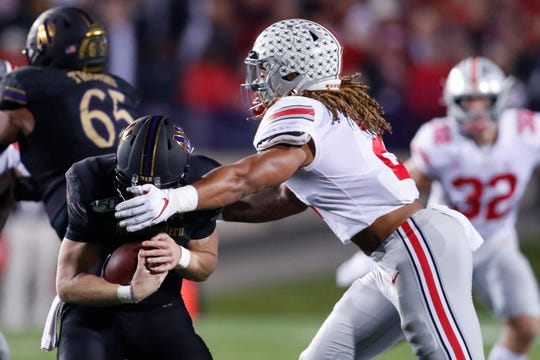 Ohio State defensive end Chase Young, right, sacks Northwestern quarterback Aidan Smith during the first half on Friday.